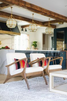 Modern accent chairs in this open floor plan home | Jean Stoffer Design