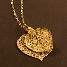 "Two 24k gold dipped aspen leaves hanging from a sparkling 18"" chain. 14k gold vermeil necklace."