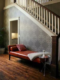 Introduce a dramatic focal wall into a living room by stenciling a wall with a creative pattern.