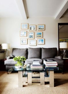 Gallery wall in neutral living room with gray sofa // the home of fashion designer Peter Som