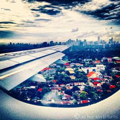 Flying into Manila, capital of the Philippines -- READ MORE: http://www.asherworldturns.com/malaysia-miscellaneous/