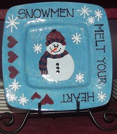 """""""Snowmen Melt Your Heart"""" Hand-painted plate with snowman, hearts and snowflakes. Snowman wearing hat and scarf."""