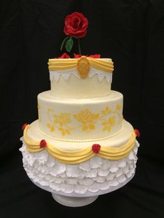 Beauty and the Beast cake: https://www.reddit.com/r/CAKEWIN/comments/4gpylc/beauty_and_the_beast_inspired_wedding_cake/