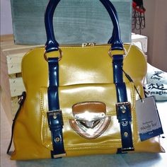 "Authentic Nicole Lee Marielle Tote Large front envelope pocket with puck button lock closure and back zip wall pocket. Double top handle with O rings at base, adjustable 26-52"" strap. Color: Mustard and Navy. 14.5"" x 12.5"" x 6"" Nicole Lee Bags Totes"