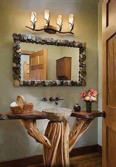 Un tronco de madera y sus ramas hacen de #lavabo de #baño. Sanitarios baños, decoración baños,