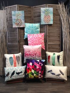 Colourful patterned and feather cushions.