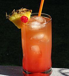 Backseat Becky :: 1 oz. Spiced Rum,  1 oz. Dark Rum,  .5oz. Malibu Coconut Rum,  .5oz. Pineapple Rum,  .5 oz Triple Sec,  4 oz. Pineapple Juice,  .5 oz Grenadine,  Pineapple Wedge and/or Cherry for garnish