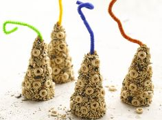 For-the-Birds Feeder....Betty Crocker: ice cream cones with pipe cleaner, covered in peanut butter, seed, Cheerios.