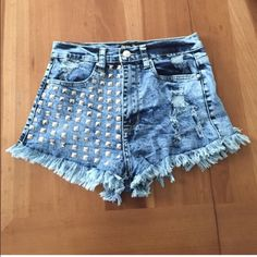 high waisted denim shorts These are awesome! The studs on these shorts add a flair that makes them extra fun to wear! These are marked mediums but I would say they run more like a small. These shorts have only been worn once! Shop hope's Shorts