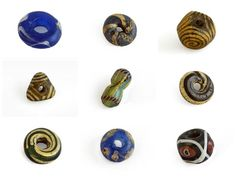 A selection of Pictish glass beads from the Northeast of Scotland, recent analysis has shown that these beads were made by reworking Roman glass.