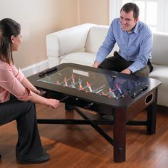 Thats right! a table AND a Foosball table hehe your guests will never be bored. Perfect for the game room.