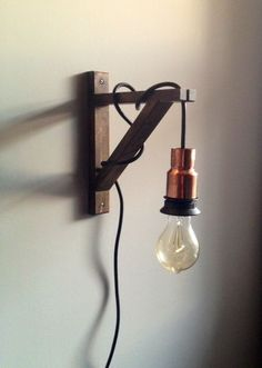 Light Up A Space For Less By Buying Your Own Cheap Lamp Cord Sets, Wooden Shelf Brackets, Copper Bushings And Edison Bulbs To Diy This West Elm Copper Light And Angler Sconce, That When Added All Together Would Cost A Little Under 90 To Buy. Copper Lamps, Copper Lighting, Sconce Lighting, Bedside Lighting, Wooden Shelf Brackets, Wooden Shelves, Shelf Bracket Light, Book Shelves, Wall Brackets