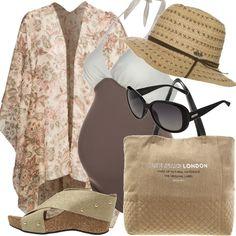 Anche le mamme in attesa possono andare al mare con una mise originale, con un pratico costume bicolore così come gli originali sandali. Senza dimenticare di ripararsi dai raggi troppo cocenti con il leggero caftano, cappellino e occhiali.