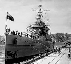 8 in County class cruiser HMAS Australia pictured brand new in Wellington, New Zealand, in 1928: she served for 26 years, unprecedented in the Australian navy at the time.  For most of WW2 she served in conjunction with the US Navy in the Pacific, losing her Captain, 6 other Officers and 23 sailors to a kamikaze strike off the Phillipines in October 1944: US compatriots believed that her 3 funnels seemed to attract them.