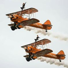 Two Britisch Wingwalkers on biplanes of the Team Breitling perform during a flight at the AIR14 air show in Payerne, Switzerland, Sunday, August 31, 2014.  #CHAOS