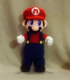 It's-a me, Mario! Wonderful Mario pattern from WolfDreamer This person has published LOTS of patterns of fan art amigurumi plushies, and they are FREE! Plushie Patterns, Crochet Toys Patterns, Stuffed Toys Patterns, Crochet Crafts, Crochet Dolls, Crochet Projects, Knitting Patterns, Fun Projects, Mario Crochet