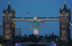 The full moon rises through the Olympic Rings hanging beneath Tower Bridge during the London 2012 Olympic Games on August The moon appears to have taken a perfect position as the sixth ring of the Olympics logo. Full Moon Rising, Moon Rise, Moon Moon, Tower Bridge London, Perfectly Timed Photos, Timing Is Everything, Cinema, Perfect Timing, Great Britain