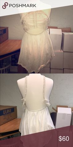 Free people New Romantics halter tank white gauze Free people gauze top sz m. Breezy cutout. Lace embroidered. NWT feel free to ask questions check out my closet I'm moving so more coming soon! Free People Tops Blouses