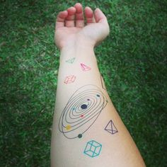 This solar system looks like it flew off the pages of the funnest science textbook. | 18 Beautiful Space Tattoos That Will Enchant You