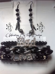 An Outfit is never completed without the right UniKreationz By Rose Accessories!!  Fashion Can Be Bought or it can be Handmade!!  Black Stackable Bracelets with drop heels earrings to match black and rhinestones