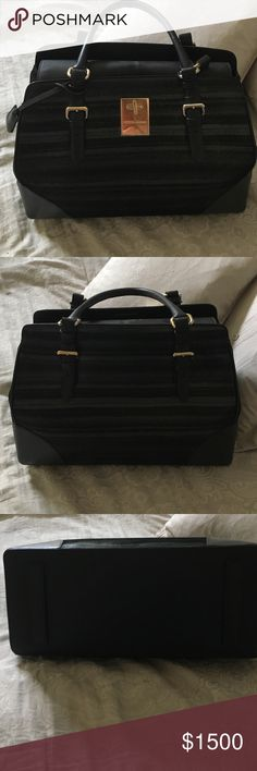 Authentic Giorgio Armani Purse!  Flash Sale! Excellent used condition.  Comes with dust bag and original price tags.  For 3 hours only price reduced to $900!!.   Giorgio Armani Bags Totes
