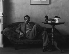 Photographer: Arnold Newman (Yasuo Kuniyoshi) ~ There is an informality to this image, a relaxed formal portrait. Newman captured a perfectly exposed scene and composed Kuniyoshi relaxed, underneath a wall of negative space. I intend to draw from the relaxation in this image to make my formal portrait less formal and more informal.