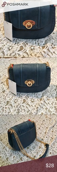 "🛍NWT/lc Lauren Conrad purse Channel a classic, yet contemporary look when you use this LC Lauren Conrad saddle bag to keep your essentials organized. PRODUCT FEATURES Stitched detailing, Chain-link accents on strap PRODUCT DETAILS 6""H x 7.5""W x 3""D, Crossbody strap: 10""-23"" drop, Rose gold-tone hardware, Twist-lock closure, Exterior: slip pocket, Interior: 2 main compartments, zip pocket & 4 slip pockets FABRIC & CARE Faux leather Polyester lining P-1 LC Lauren Conrad Bags Mini Bags"