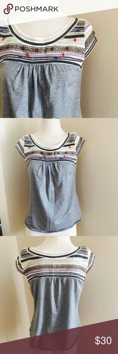 """Anthropologie embroidered blouse One September top with front embroidery. 18"""" flat bust,25"""" length. Content is 74 poly , 20 metallic , 6 spandex. In excellent condition . No trades. Anthropologie Tops Blouses"""