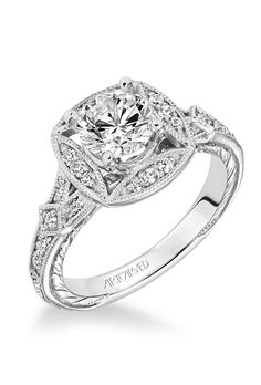 "Brides.com: . Style V629, ""Lorraine"" vintage-inspired diamond prong-set engagement ring with intricate halo design and hand engraved milgrain details, $1,800 (for setting only), ArtCarved"