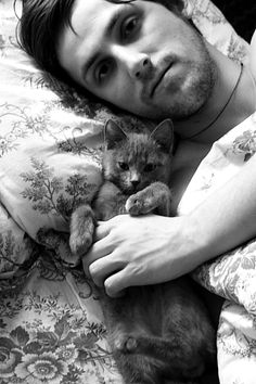 A hot man and a cute kitten...What could be any better?