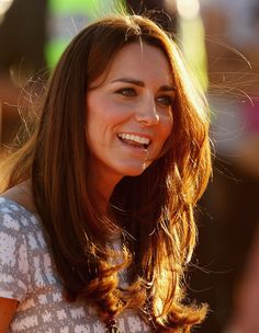 Catherine, Duchess of Cambridge smiles after walking down Kuniya Walk at the base of Uluru on April 22, 2014 in Ayers Rock, Australia. The Duke and Duchess of Cambridge are on a three-week tour of Australia and New Zealand, the first official trip overseas with their son, Prince George of Cambridge.