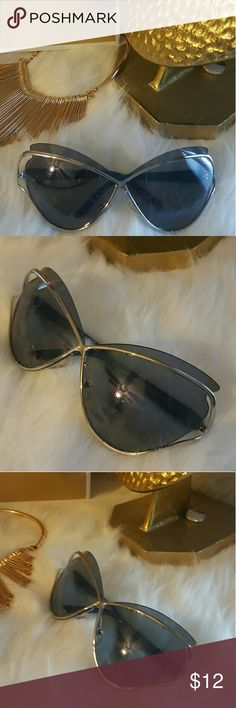 Cool oversized sunglasses Great condition.  Never worn. Oversized Cateye lens, with blue arms Accessories Sunglasses