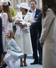 CP Victoria holding Prince Oscar with Chris O'Neill in the background.  Estelle doing a dance and the back of Princess Madeleine.  70th Birthday celebrations of King Carl Gustaf
