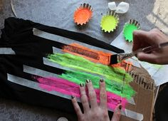 shirt neon acrylic paint acrylic paint fabric additive coarse bristled paintbrush thin masking tape heavy cardboard