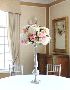white baroque stands with floral upgrade to extra full flowers