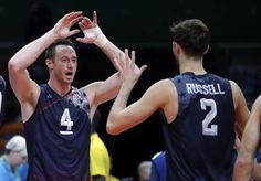 US men's volleyball team beats Mexico to reach quarterfinals: August 15, 2016 - United States' David Lee (4) celebrates with teammate Aaron Russell after defeating Mexico during a men's preliminary volleyball match at the 2016 Summer Olympics in Rio de Janeiro, Brazil, Monday, Aug. 15, 2016. (AP Photo/Jeff Roberson)