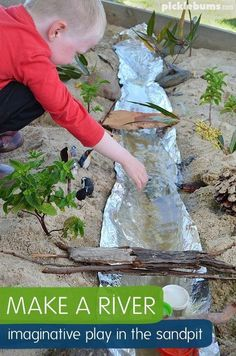 Make a River! Imaginative play in the sand box.