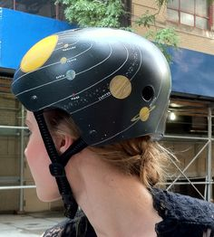 Scoutmob Shoppe has some rad hand-painted Belle Helmets on sale, like this solar system one!