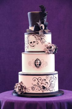 I truly loved making this cake - all of the elements are completely my style. I hand painted the designs with Americolor Super Black, and also made the cameo by hand. :)