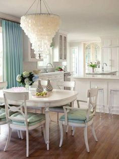 Kitchen Lovely Chandelier Bar Stools Ideas Blue Curtain Glass Window Beside White Paint Cabinet Dining Table Design Spectacular for