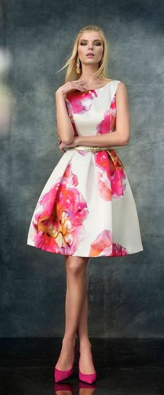Sleeveless, floral print, shiny crepe dress with a scoop neck, darts and box pleated skirt bottom. Invisible closure at back. Fabric 100% Polyester