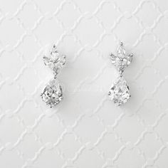 Simple and classic wedding earrings designed with a pear drop hanging from three marquise jewel leaves. Truly perfect for any special occasion.