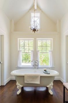 White Vintage Bathroom with Wood Floors and Standalone Bath Tub Wood Floor Bathroom, Modern Bathroom Decor, Bathroom Interior, Home Decor Bedroom, Moble Homes, New England Cottage, Amazon Home Decor, Relaxing Bathroom, Cottage Style Homes