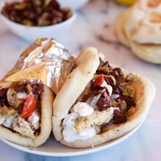 Greek marinated Chicken Gyros with homemade pita, Tzatziki and Feta Cheese! The best Greek dinner I have made!