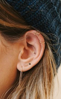 Accessorize your ear with gold jewels from top to bottom. So chic.