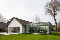 a farmhouse in belgium from the 1970's, modified and extended, creating a new relationship with the outdoors. It's beautiful on the outside and in, I suggest taking a look.