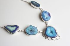 This necklace makes the perfect statement, great to wear with collard shirts or add a unique statement piece to a jumper or dress. The beautiful slices of agate used in this necklace are all individual and unique This necklace has a 925 silver overlay.