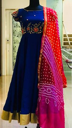 Hand Embroidery Beautiful royal blue color floor length anarkali dress with floret lata design hand embroidery gold thread and kundan work. Ananrkali dress with red and pink combination banduni dupatta. Ananrkali dress with gold boarder. 15 May 2018 - Kurti Designs Party Wear, Kurta Designs, Blouse Designs, Dress Designs, Indian Gowns Dresses, Indian Outfits, Indian Clothes, Long Gown Dress, Long Frock