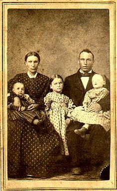 Family photo....Father is holding deceased child.