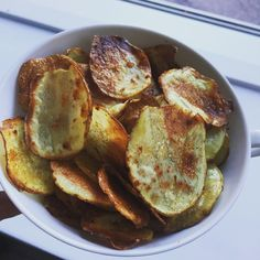 Homemade potato Chips. With salt paprika and chili Oil.